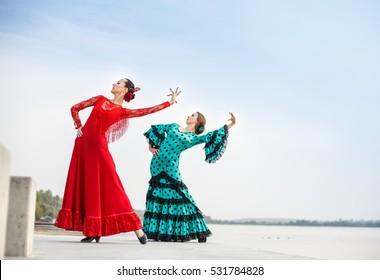 Flamenco dancers Spain woman in a long dress on the lake
