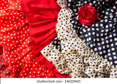 Flamenco dresses in red and blue with spot with red rose typical from Spain Espana