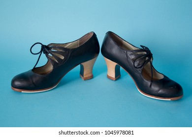 Flamenco shoes on blue background
