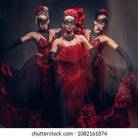 Flamenco spanish seductive dancers wearing traditional costume.