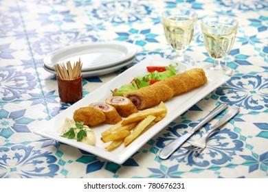 flamenquin, deep fried long pork roulade, spanish cordoba cuisine