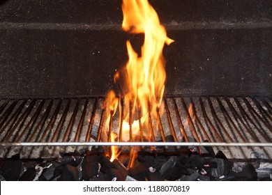 Flames in a barbecue. They have a yellow color. Front view, in outside and without character.