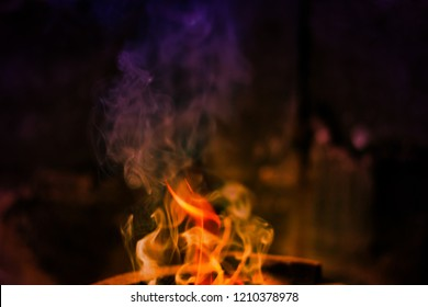 The flames are burning in the furnace. Blazing flames flare in the furnace.