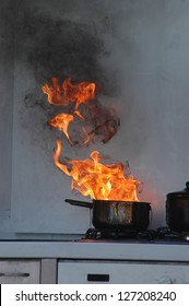 flames from burning oil on a kitchen stove