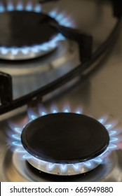 flames burning on a gas stove in the kitchen