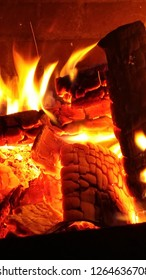 flames during summer in a brick firepit
