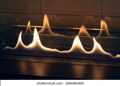 The flames in electric fireplace close-up. Interior