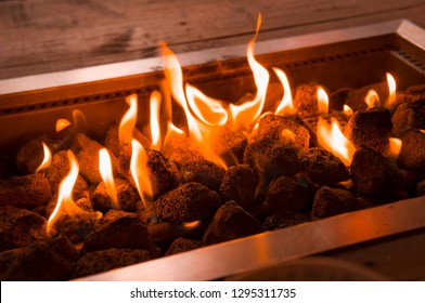 Flames leaping from a Gas Powered Fire Pit