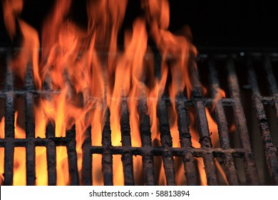 Flames over a grill.