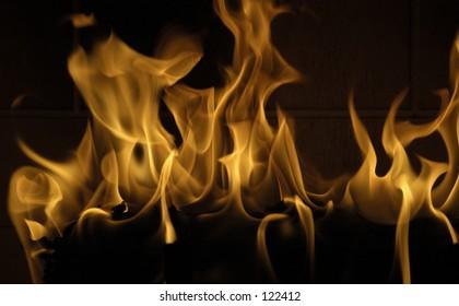 Flames roar in a cozy fireplace