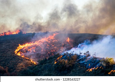 Flames and Smoke with Burning Landscape during Woolsey Fire
