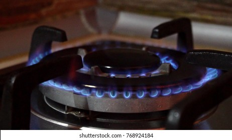 Flames in a stove burner in the kitchen. Close-up shot