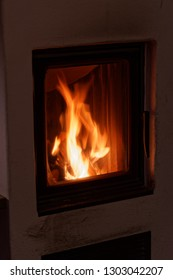 Flames in a wood burning stove in a house