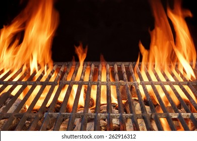Flaming Empty Hot Barbecue Charcoal Grill With Glowing Coals On Black Background