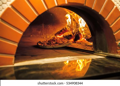 Flaming Hot Wood Fired Pizza Baking in an Oven