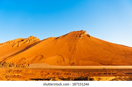 The Flaming Mountains are barren, eroded, red sandstone hills in Tian Shan Mountain range, Xinjiang, China.