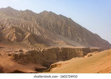 Flaming Mountains or Gaochang Mountains are barren, eroded, red sandstone hills near Turpan, Xinjiang, China