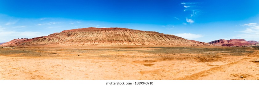 "Flaming mountains, Turpan, Xinjiang, China: these intense red arid mountains similar to scorching flames appear in the Chinese epic ""Journey to the west"". Turpan is an ancient oasis on the Silk Road"