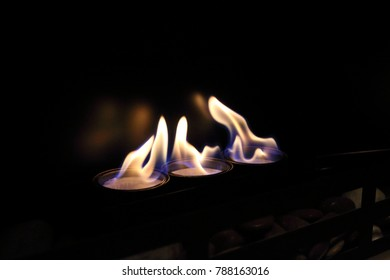 Flaming round ethanol burners of a modern bio fireplace
