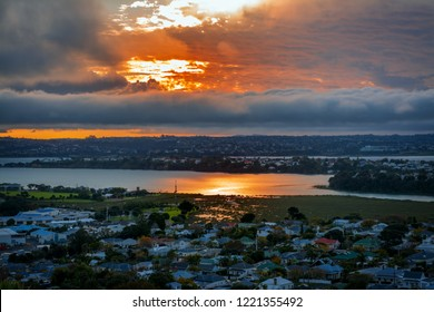Flaming sku over Auckland Harbour and suburb of Devonport. Auckland, New Zealand