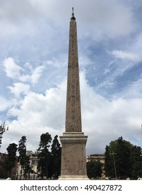 Flaminio Obelisk (Obelisco Flaminio) in the Piazza del Popolo in Rome, Italy. Obelisk is from Pharaoh Ramses II of Egypt, 13th Century BC.   Erected in the piazza by Pope Sixtus V.