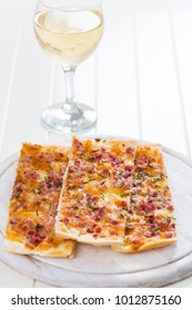 Flammkuchen or Traditional Alsatian Pie, Tart flambe with glas of wine