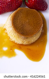 flan with caramel and strawberries