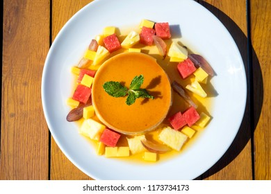 flan with vegetable toping.  flan, in English and other cuisines, is a dish with an open, rimmed pastry or sponge base containing a sweet or savoury filling