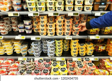 FLANDERS, BELGIUM - OCTOBER 20, 2016: Fresh dairy products of Danio a Danone brand in cooler with desserts of a Carrefour Hypermarket.