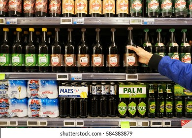 FLANDERS, BELGIUM - OCTOBER 20, 2016: Aisle with various brands and different types of Small beers in a Carrefour Hypermarket. Small ale is a beer/ale that contains very little alcohol.