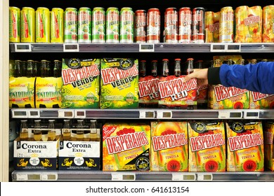 FLANDERS, BELGIUM - OCTOBER 20, 2016: Aisle with various Special beers in a Carrefour Hypermarket. Desperados Beer is a pale lager flavored with tequila owned by the Dutch brewing company Heineken.