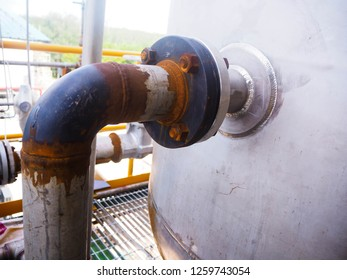 Flange and rust of water tank in power plant.