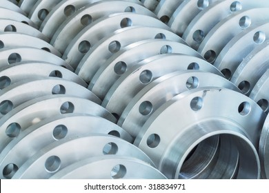Flanges stacked in warehouse, selective focused