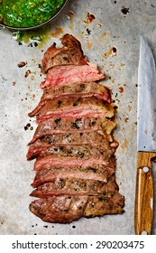 flank steak  with chimichurri sauce. healthy food. style vintage. top view. selective focus