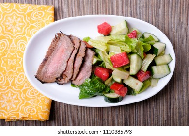 flank steak with side summer salad, a ketogenic diet meal