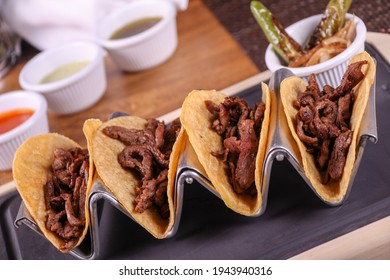 "Flank steak tacos with roasted chili peppers and onions ""tacos de arrachera con chiles toreados"""
