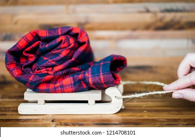 Flannel red shirt on wooden sleds.