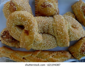 FLAOUNES - Cyprus Easter cakes made of outer pastry casing and a stuffing of cheese, egg and rasins. Also large Easter biscuit without stuffing