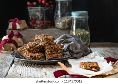 Flapjack of oats, pumpkin seeds, sunflower seeds and dried fruit, in gift packets for Christmas