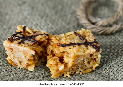 Flapjack snack bar with a chocolate decoration.