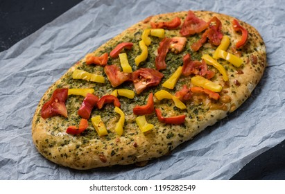Flapjack with vegetables, spices and cheese, top view