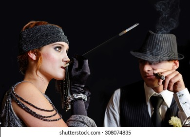 flapper girl smoking and young gangster in hat