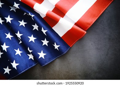 Flapping flag USA with wave. American flag for Memorial Day or 4th of July. Closeup of American flag on dark background