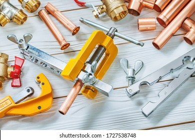 flaring pipe set of tools or this clamps brake plumper cutter fittings fixtures valwes on wooden boards