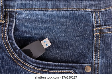 Flash drive in the front pocket of blue jeans