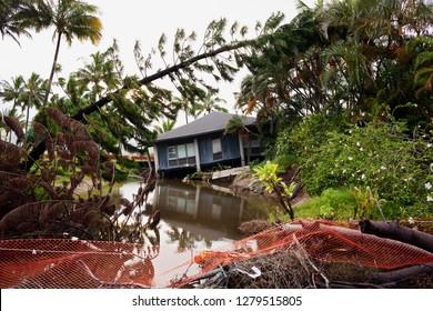 Flash flooded damaged houses in Hanalei Bay, Kauai, Hawaii, USA
