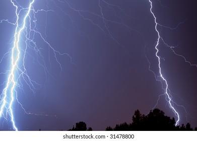 The flash of lightning in night sky