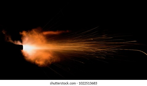 the flash from a shot from a firearm on a black background