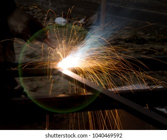 Flash and sparks from electric welding