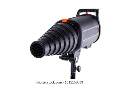 Flash tube strobe close up. Pulse studio flash with a conical snoot on a stand isolated white background. Professional photo equipment.
